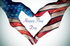 The text happy flag day written in the blank space of a heart sign made with Stock Photos