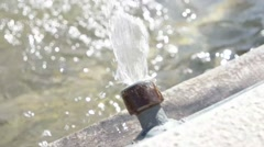 Water pouring into fountain very closeup slowmo - stock footage
