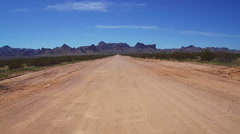 Viewpoint Motorcyclist On Dirt Road To Black Mnts- Golden Valley AZ Stock Footage
