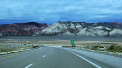 POV-Driving Interstate-70 westbound in central Utah on a bright but cloudy day Stock Footage