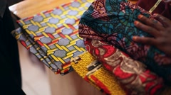 Sewing African fabrics sort - stock footage