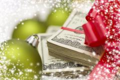 Stack of Hundred Dollar Bills with Bow Near Christmas Ornaments Stock Photos