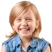 Cute happy girl laughing and having fun - stock photo