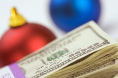 Money and Christmas Ornaments with Narrow Depth of Field. Stock Photos
