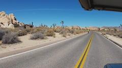 RV Viewpoint Passing Bike Riders- Joshua Tree National Park Stock Footage