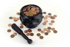 Grinding for Pennies - stock photo