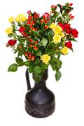 Roses and hypericum flowers in ceramic vase Stock Photos