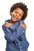 Handsome boy shyly laughs. Malicious smile. - stock photo