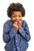 Harmful black boy slyly laughs Stock Photos