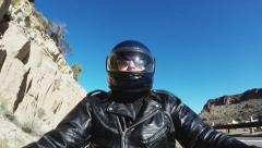 Helmeted Motorcycle Rider On Western Canyon Road Stock Footage