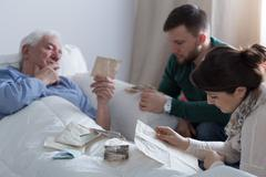 Kids and dying father - stock photo
