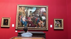 Man Looking At Paintings In Art Gallery Stock Footage