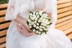 Wedding bouquet in hands of the bride Stock Photos