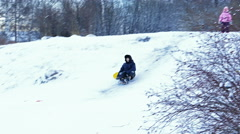 Kids Enjoying Snow Sledge Slide Stock Footage