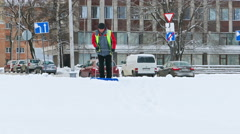Janitor Cleaning Street after Heavy Snowfall in Petrozavodsk, Russia Stock Footage