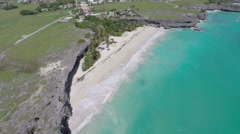 Flying high over the rugged and rocky coastline of Barbados Stock Footage