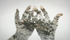 Hands ashes DE Stock Footage