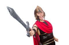 Stock Photo of Gladiator holding sword isolated on white