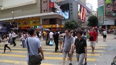 People on a pedestrian crossing in the Central District of Hong Kong Stock Footage