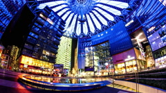 Time-lapse of Pedestrians pass by at the Sony Center in Berlin - stock footage