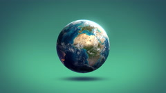 Rotating Earth on a studio background Stock Footage