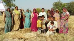 Indian village farming family, long shot, shallow DOF Stock Footage