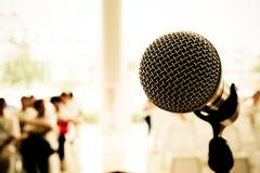 Microphone in concert hall or conference room - stock photo