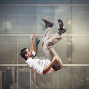 Businessman rushes down - stock photo