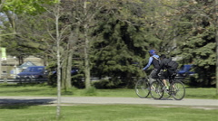 Cyclists riding in the Park. 4K UHD. - stock footage