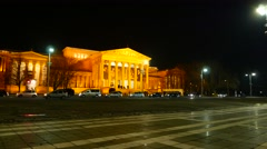 Traffic pass by in front of the Museum of Fine Arts in Budapest at night Stock Footage