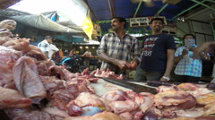Men in front of stand with meat at market in Mumbai. Stock Footage
