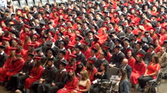 4K TIght overhead shot of high school graduates in cap and gowns Stock Footage