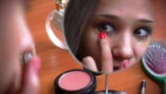 Young beautiful woman smears the face tone cream and smiling before a mirror Stock Footage