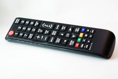 Remote TV in studio light - stock photo