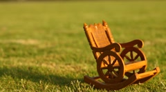 Antic Wood Chair in the lawn - stock footage