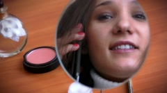 Young beautiful woman talking on phone, looks in mirror and coquettishly smiling Stock Footage
