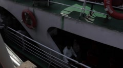 Indian boat mooring and people go ashore and go on board the day and night Stock Footage