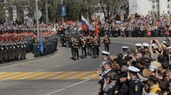 SEVASTOPOL,CRIMEA/RUSSIA: The line of military with flags marches on parade Stock Footage