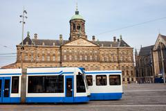 Royal Palace and Trams in Amsterdam - stock photo