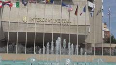 Landmark five stars hotel in Romania Bucharest, Intercontinental building, flags Stock Footage