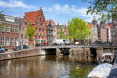 Amsterdam Canal, Bridge and Houses - stock photo