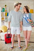 Travelers with tickets and suitcase Stock Photos