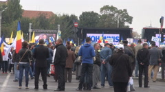 Lots of people in crowded place wave national flags, good citizens protest Stock Footage
