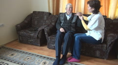 Old ill man with female doctor at nursing home, kinetic therapy, health care Stock Footage