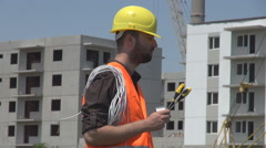 Panoramic shot inside construction site development, engineer with screwdrivers Stock Footage