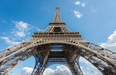 The Eiffel Tower over blue sky, bottom-up view Stock Photos