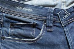 Blue denim jeans pocket with design torn Stock Photos