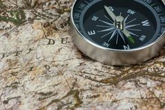 Stock Photo of Finding Your Direction - Compass and Map