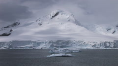 Dark clouds, icebergs and mountain landscape Stock Footage
