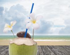 Stock Photo of Fresh coconut drink with nice beach background